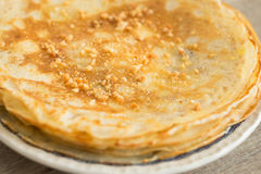 Stack of homemade wheat pancakes with honey Royalty Free Stock Photos
