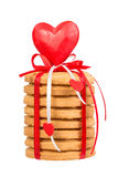 Stack of honey cake decorated with red ribbon and heart Stock Image