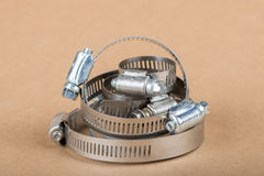 Stack of Hose Clamps. Stack of shiny hose clamps on light background Royalty Free Stock Photos