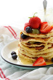 Stack of hot pancakes with fruits Stock Photo