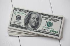 A stack of hundred dollar bills American dollars Stock Photo
