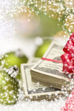 Stack of Hundred Dollar Bills with Bow Near Christmas Ornaments Stock Images