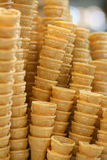A stack of ice cream cones. Neat stacks of ice cream cones royalty free stock images