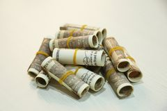 Stack of Indian 10 rupee currency note rolls. On the wooden table stock image