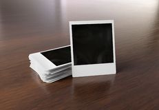 Stack of instant photos on wooden surface 3D rendering. Stack of instant photos on wooden surface Mockup 3D rendering royalty free illustration