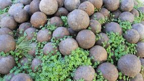 Stack of iron  cannonballs on Historic Old Town Of Rethimno. Ancient steel cannonballs on Historic site old town of Rethimno in Crete Island Greece Stock Photography
