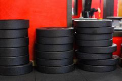 A stack of iron disc weights in a gym royalty free stock photos
