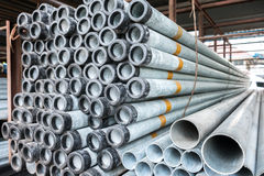 Stack of iron pipes Stock Images