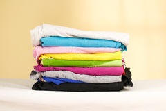 Stack of ironed colored linen. Pile of clothes. Ironing concept. Stock Image