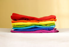 Stack of ironed colored linen. Pile of clothes. Ironing concept. Stock Images