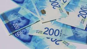 Stack of Israeli money bills of 200 shekel - Pan left stock video