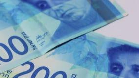 Stack of Israeli money bills of 200 shekel - Tilt down stock video