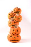 Stack of Jack-o-lanterns. A stack of several carved jack-o-lanterns made of a foam material for halloween decoration.  piece is hollow and lights up Royalty Free Stock Photo