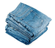 Stack of jeans. On white background stock photos