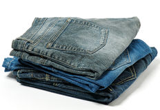 Stack of jeans. Isolated on white background Royalty Free Stock Image
