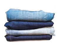 Stack of jeans. In different colors  on white background Royalty Free Stock Photos