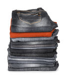 Stack of jeans brown and black Stock Images