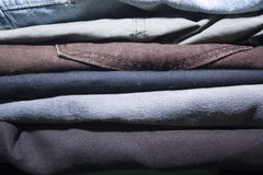 Stack of jeans. Of different colors Stock Photos