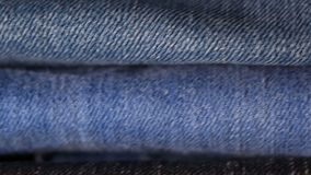 Stack of jeans. In different colors stock footage