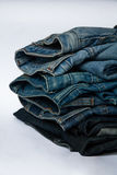 Stack of jeans fashion Background different denim layers colors. Denim jeans texture design fashion Royalty Free Stock Images