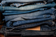 Stack of jeans fashion Background different denim layers colors. Denim jeans texture design fashion Stock Photo