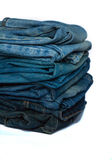 Stack of jeans fashion Background different denim layers colors. Denim jeans texture design fashion Royalty Free Stock Photography