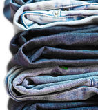 Stack of jeans isolated closeup Stock Photo