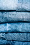 Stack of jeans on table. Zero vaste concept. Ecology and recycling royalty free stock image