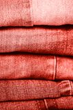 Stack of jeans on table. Zero vaste concept. Ecology and recycling. Living coral concept royalty free stock photos