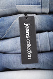 Stack of jeans with tag Royalty Free Stock Photo