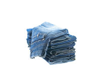 Stack of jeans trousers Royalty Free Stock Photos