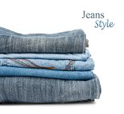 Stack of jeans trousers isolated Stock Images