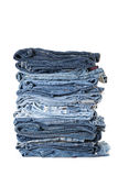 Stack of jeans on white background Royalty Free Stock Photo