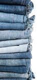 Stack of jeans on white background Royalty Free Stock Photos