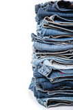 Stack of jeans on white background Stock Photography