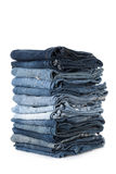 Stack of jeans on white background Stock Photos