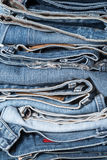 Stack of jeans on white background Stock Image