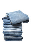 Stack of jeans on white background Royalty Free Stock Photography