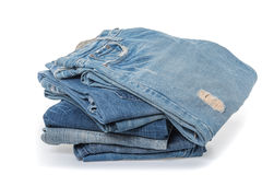 Stack of jeans on white background Royalty Free Stock Images