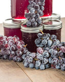 Stack of jelly jars with grapes Stock Photos