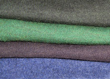 Stack of jumpers. In various colours Royalty Free Stock Photography