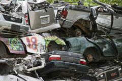 Stack of Junked Cars Close UP. Close up a a pile of wrecked cars at a metal salvage yard Royalty Free Stock Image