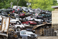 Stack of Junked Cars. Huge pile of wrecked cars at a metal salvage yard Royalty Free Stock Image