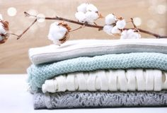 Stack knitted clothes cotton flower royalty free stock photo