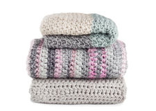 Stack of knitted scarfs isolated on white background. Stack of knitted scarfs isolated on white Royalty Free Stock Photo