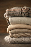 Stack of knitted sweaters Stock Images