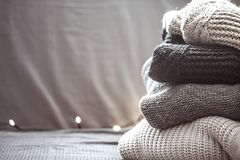 A stack of knitted sweaters. The concept of warmth and comfort, hobby , background,closeup Royalty Free Stock Images