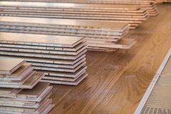 Stack of laminated wooden flooring boards. Prepared for installation royalty free stock photos