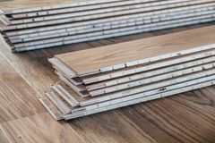 Stack of laminated wooden flooring boards. Prepared for installation royalty free stock images