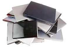 Stack of laptops. Stack of used laptop computers, upper view, isolated on white Stock Photos